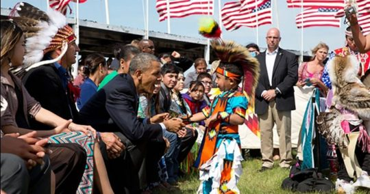 President Barack Obama greets a young boy during the Cannon Ball Flag Day Celebration at the Standing Rock Sioux Tribe Reservation in Cannon Ball, N.D., on June 13. It was the first visit by a sitting president to Indian Country in 14 years.